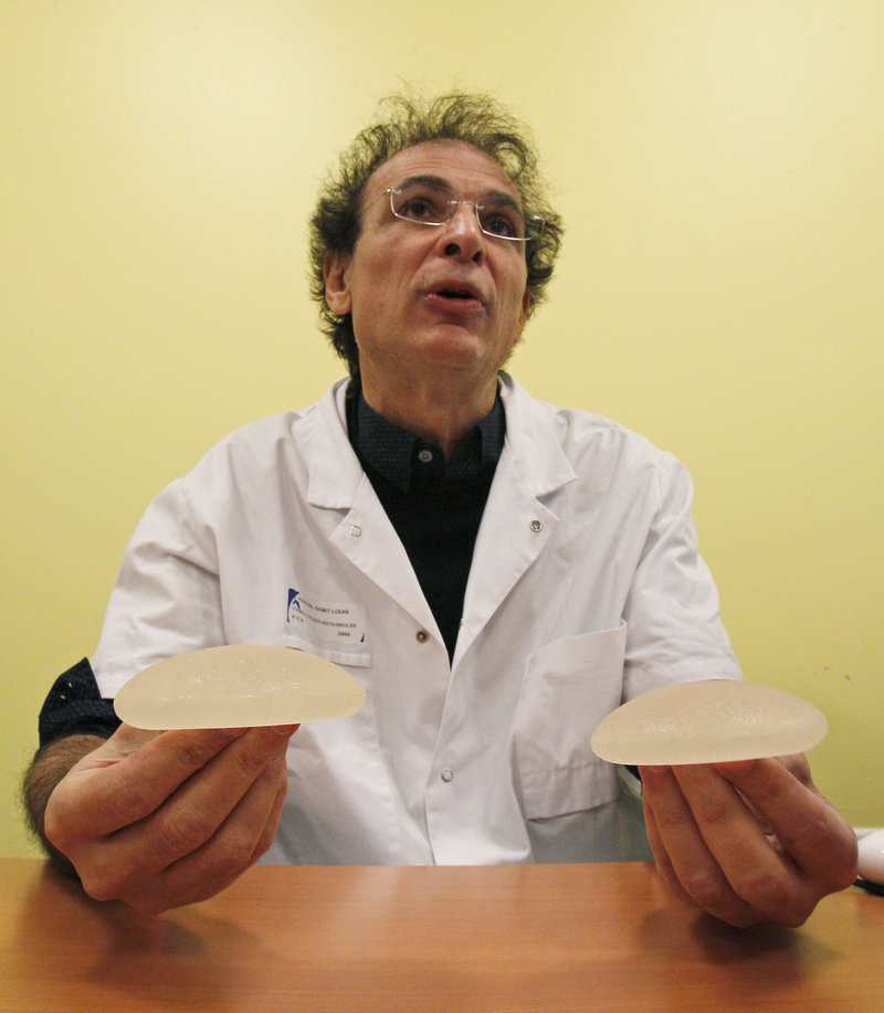 Dr. Maurice Mimoun, a plastic surgeon, holds silicone-gel breast implants, made by a French company, that have raised health concerns.
