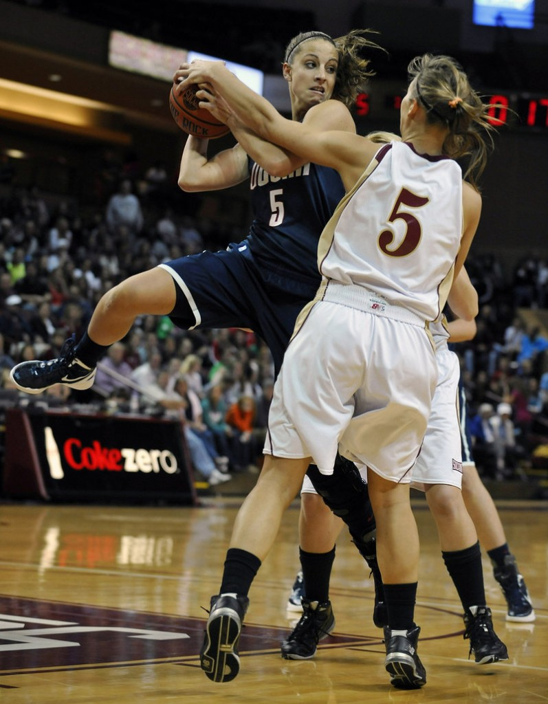 Caroline Doty of Connecticut looks to pass Wednesday night while defended by Cathryn Hardy of the College of Charleston. UConn, coming off a loss to Baylor, won 72-24.