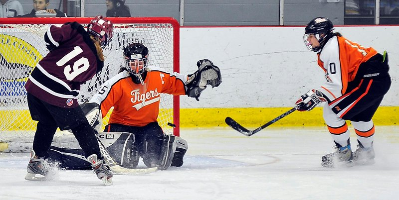Biddeford goalie Emily Brassley holds her ground and stops a shot by Charlotte Smith of Gorham-Bonny Eagle. Smith did score two goals Wednesday night as Gorham-Bonny Eagle came away with a 5-4 victory.