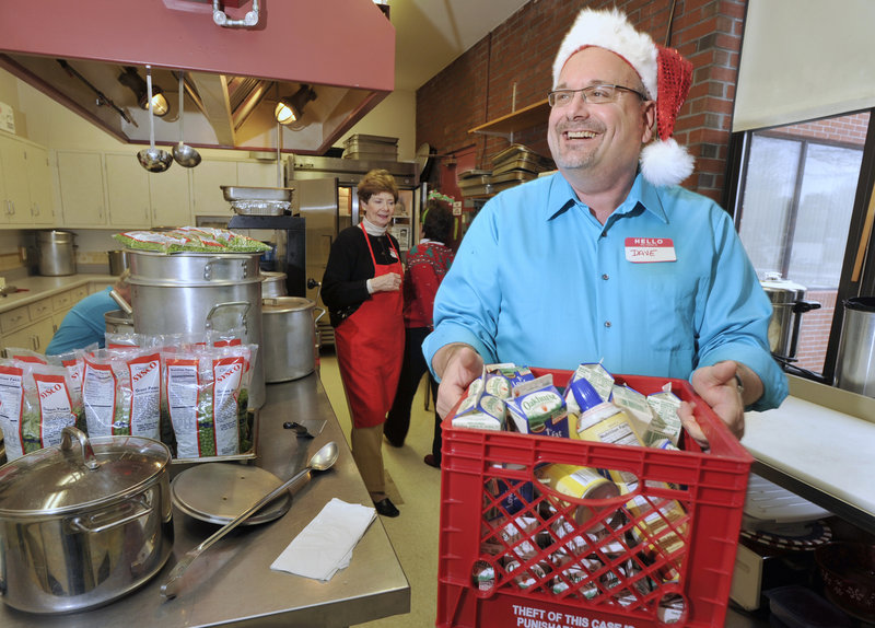 Dave Nadeau gets into the spirit of Christmas by wearing a Santa hat while volunteering at the Westbrook-Warren Congregational Church's annual Christmas dinner for community members Sunday.