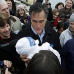 Republican presidential candidate former Massachusetts Gov. Mitt Romney holds up 2-month-old Anne Martin, of Portsmouth, N.H., during a campaign stop.