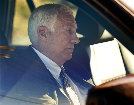 Former Penn State football defensive coordinator Jerry Sandusky sits in a car as he leaves the office of Centre County Magisterial District Judge Leslie A. Dutchcot on Saturday, Nov. 5, 2011, in State College, Pa. Sandusky was arrested again Wednesday on new sex-abuse charges from new accusers. (AP Photo/Andy Colwell, The Patriot-News)