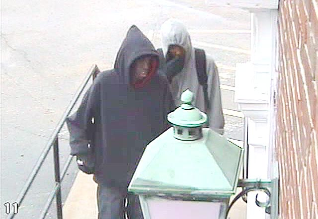 Security cam images of suspects in credit union robbery today.