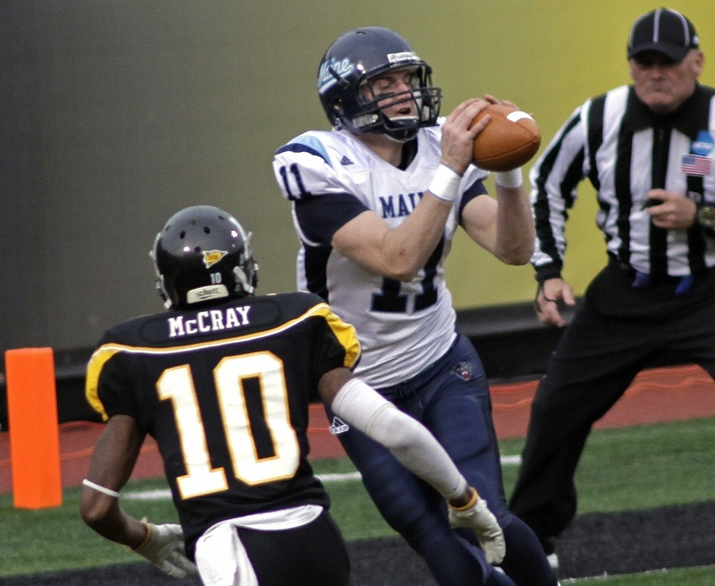 John Ebeling of the University of Maine breaks away from Demetrius McCray of Appalachian State to catch a third-quarter touchdown pass, giving the Black Bears a 27-6 lead on the way to a 34-12 victory and a quarterfinal berth against second-ranked Georgia Southern.