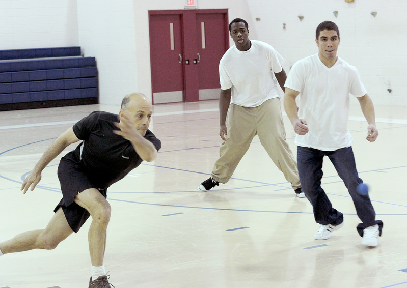Ron Cramer, a retired police officer from San Francisco, plays handball recently with Alex Julien and E.J. Rosario at the Long Creek Youth Development Center in South Portland.