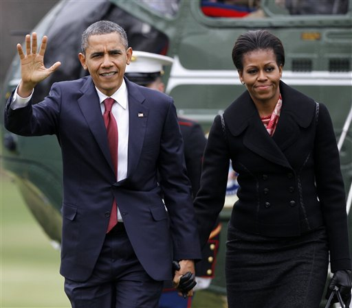FILE - In this Dec. 14, 2011 file photo, President Barack Obama and first lady Michelle Obama arrive on the South Lawn of the White House in Washington. First lady Michelle Obama is a behind-the-scenes force in the White House whose opinions on policy and politics drew her into conflict with presidential advisers and who bristled at some of the demands and constraints of life as the president's wife, according to a detailed account of the first couple's relationship. (AP Photo/Haraz N. Ghanbari, File) FILE - In this Dec. 14, 2011 file photo, President Barack Obama and first lady Michelle Obama arrive on the South Lawn of the White House in Washington. First lady Michelle Obama is a behind-the-scenes force in the White House whose opinions on policy and politics drew her into conflict with presidential advisers and who bristled at some of the demands and constraints of life as the president's wife, according to a detailed account of the first couple's relationship. (AP Photo/Haraz N. Ghanbari, File)