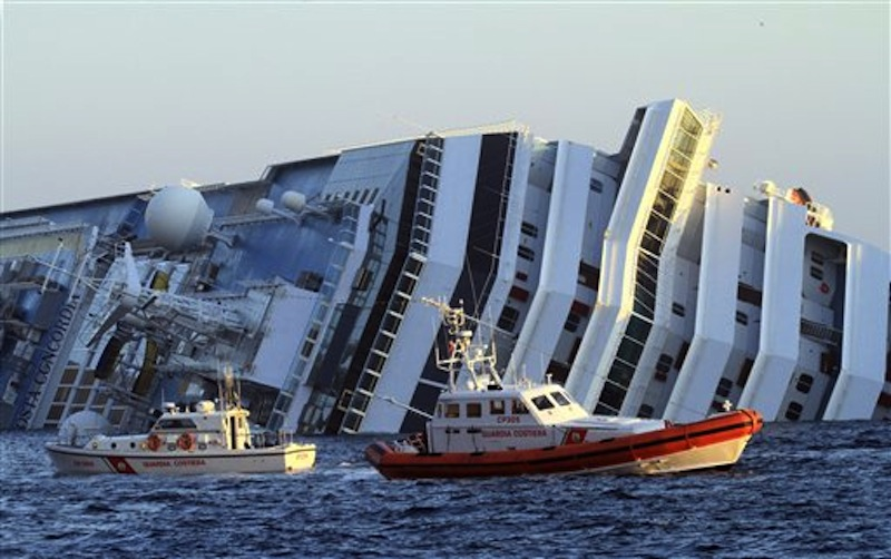 The luxury cruise ship Costa Concordia leans on its side as after running aground off the tiny Tuscan island of Giglio. (AP Photo/Enzo Russo)