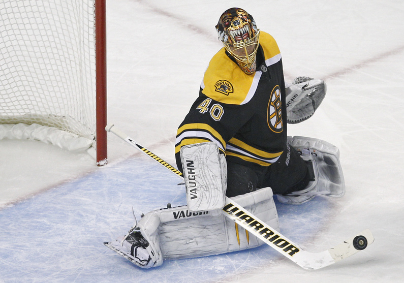 Boston Bruins goalie Tuukka Rask makes a stick-save in the Bruins' 9-0 shutout against the Calgary Flames in Boston tonight.