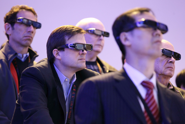 Attendees watch a 3-D HDTV presentation by Panasonic at last year's Consumer Electronics Show.