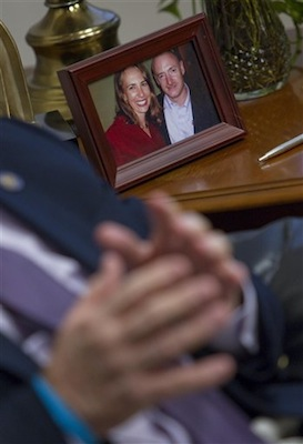 Ron Barber, backdropped by a photo of U.S. Rep. Gabrielle Giffords and her husband, Mark Kelly, recounts the day he was shot. Barber, A staffer for Giffords, was shot one year ago while working a Giffords event where a gunman opened fire on Giffords and the crowd. (AP Photo/Matt York)