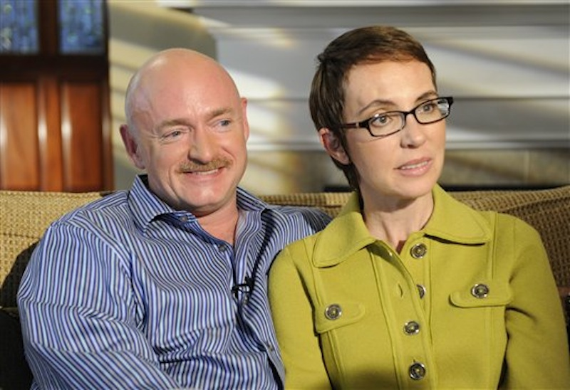 U.S. Rep. Gabrielle Giffords and husband Mark Kelly are interviewed by Diane Sawyer on ABC's 20/20. One year after being shot in the head, Rep. Gabrielle Giffords is on a mission to return to the job she so clearly loved. (AP Photo/ABC, Ida Mae Astute)
