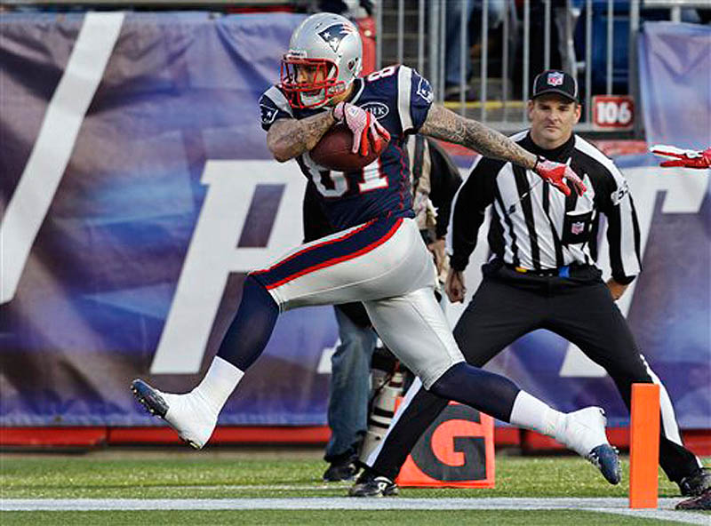 New England Patriots tight end Aaron Hernandez (81) steps into the end zone for a touchdown during the second quarter of an NFL football game against the Buffalo Bills in Foxborough, Mass. (AP Photo/Stephan Savoia) NFLACTION11;