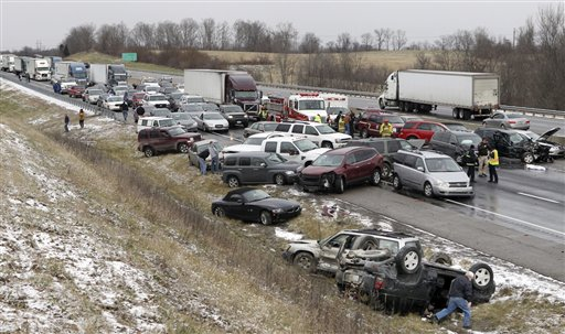 Emergency crews work the scene after a crash along Interstate 75 that involved 41 cars during snowy conditions Monday near Dry Ridge, Ky. No life-threatening injuries were reported. The road reopened around 3 p.m. on Monday after being shut down for about three hours from the pileup.