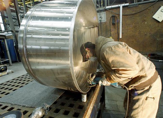 Chris Keltz polishes a tank JV Northwest, in Canby, Ore., recently. JV Northwest manufactures stainless steel vessels.
