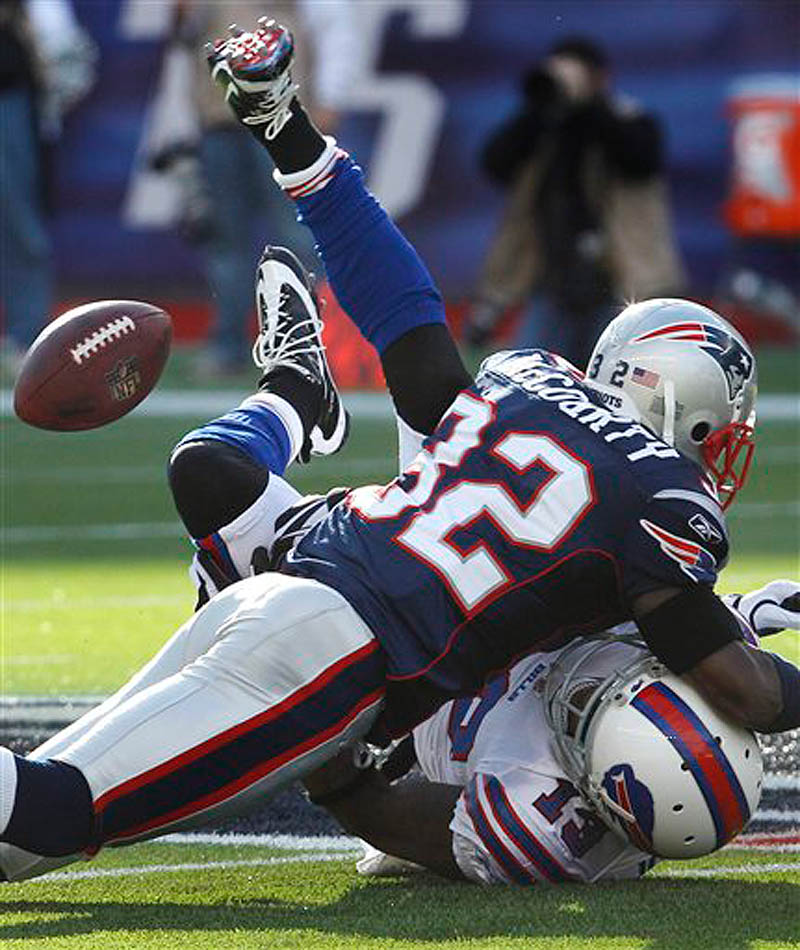 New England Patriots cornerback Devin McCourty (32) levels Buffalo Bills wide receiver Steve Johnson (13) on a pass route during the first quarter of an NFL football game in Foxborough, Mass., Sunday Jan. 1, 2012. (AP Photo/Charles Krupa) NFLACTION11;