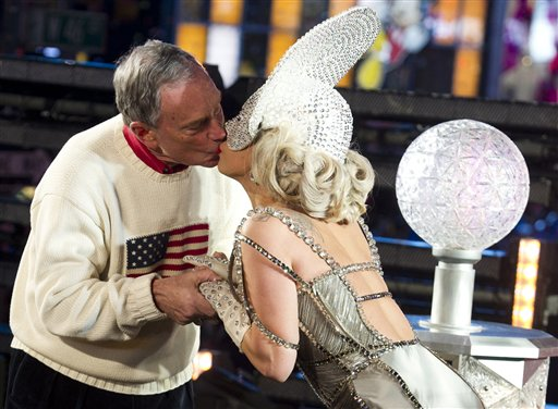 Lady Gaga and New York Mayor Michael Bloomberg, left, kiss during the New Year's celebration on Sunday.