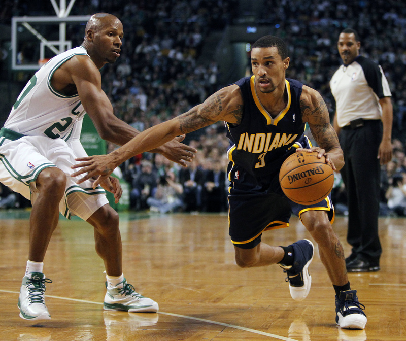 George Hill of the Indiana Pacers drives past Boston's Ray Allen Friday night. The Pacers won, 87-74.