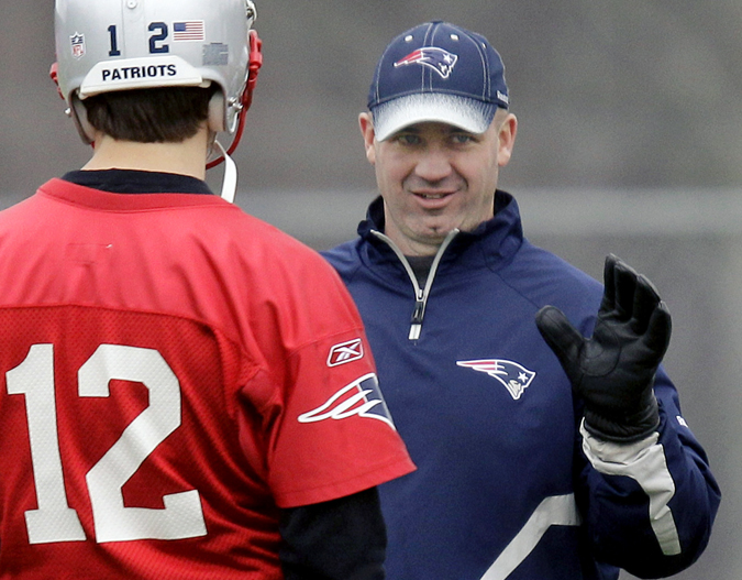 In this Dec. 14, 2011, photo, New England Patriots offensive coordinator/quarterbacks coach Bill O'Brien talks with quarterback Tom Brady during a practice in Foxborough, Mass.