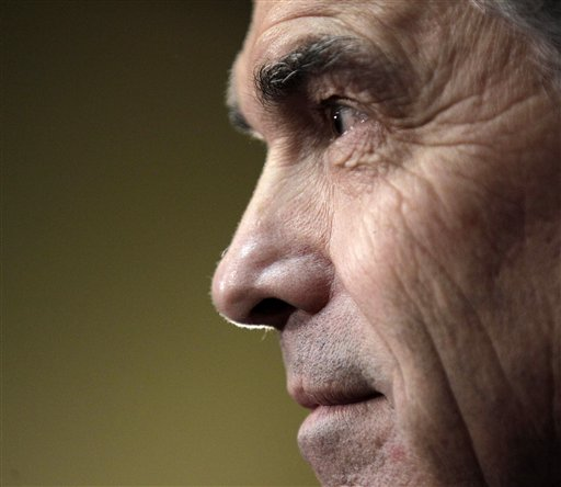 Republican presidential candidate Texas Gov. Rick Perry listens to a question during a campaign stop in Fort Dodge, Iowa, Saturday, Dec. 31, 2011. (AP Photo/Charlie Riedel)