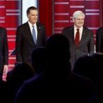 Republican presidential candidates, from left, former Pennsylvania Sen. Rick Santorum, Texas Gov. Rick Perry, former Massachusetts Gov. Mitt Romney, former Speaker of the House Newt Gingrich, Rep. Ron Paul, R-Texas, and Rep. Michele Bachmann, R-Minn, stand together prior to their Republican debate in Des Moines, Iowa, on Dec. 1.