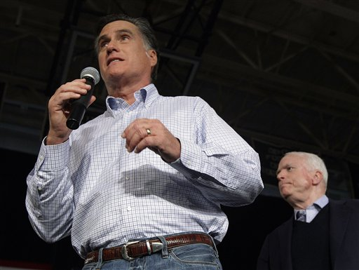 Republican presidential candidate Mitt Romney campaigns with Arizona Sen. John McCain, right, during a town hall style meeting in Manchester, N.H., on Wednesday.