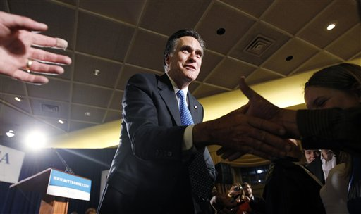 Republican presidential candidate, former Massachusetts Gov. Mitt Romney, greets supporters at his caucus night rally in Des Moines, Iowa, Tuesday.