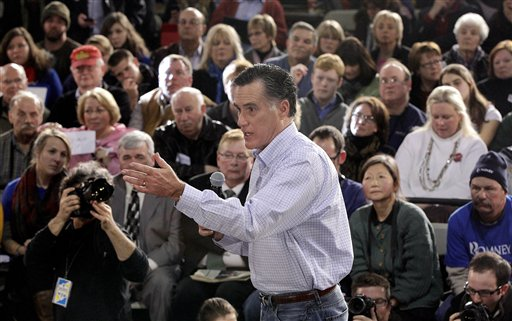 Mitt Romney campaigns during a town hall-style meeting in Manchester, N.H., on Wednesday. In Iowa, the biggest PAC player was Romney's allegedly independent Restore Our Future PAC.