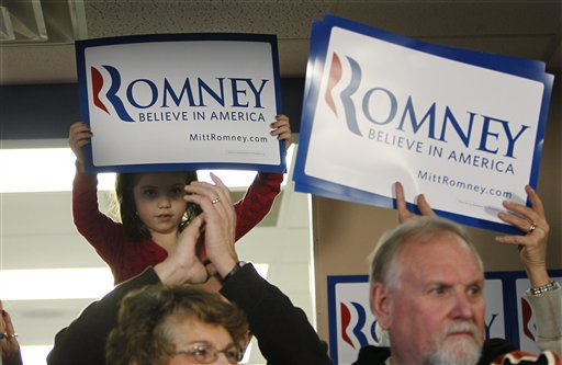Supporters of Republican presidential candidate, former Massachusetts Gov. Mitt Romney listen during a campaign stop, Saturday, Dec. 31, 2011, in Le Mars, Iowa. (AP Photo/Eric Gay)