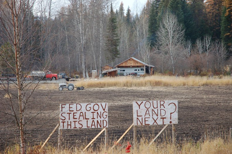 Irate neighbors erected these signs to protest a U.S. Environmental Protection Agency decision that wetlands exist on property at Priest Lake in Idaho, requiring a permit to disturb the land for a home.