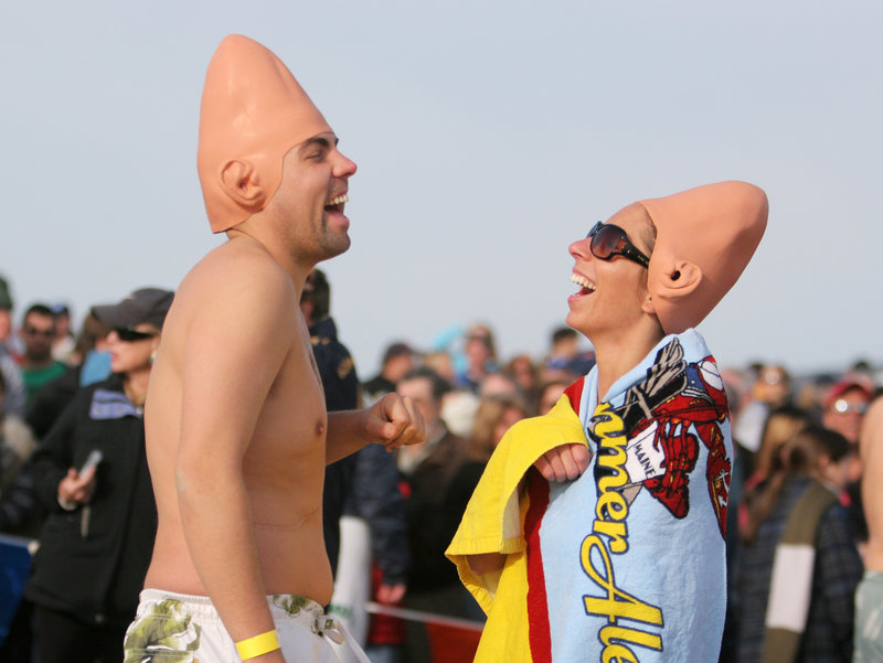 Patrick Choiniere of Saco and Katrina Botelho of Old Orchard Beach show off their coneheads before taking the plunge at the 2011 Lobster Dip.