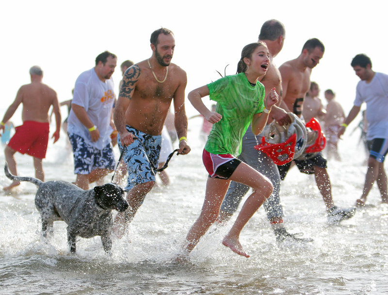 Dippers race back to the beach after taking their icy plunge during the 2011 Lobster dip.