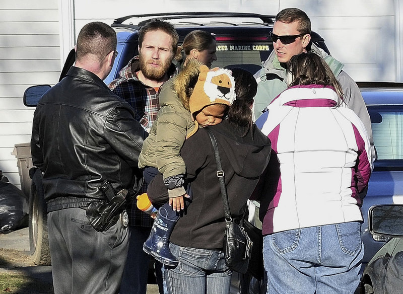 DiPietro, second from left, is questioned by police on the day after he reported the little girl missing.