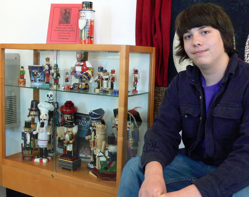 Eri Martin, 14, poses with his collection of nutcrackers at the Windham Public Library.