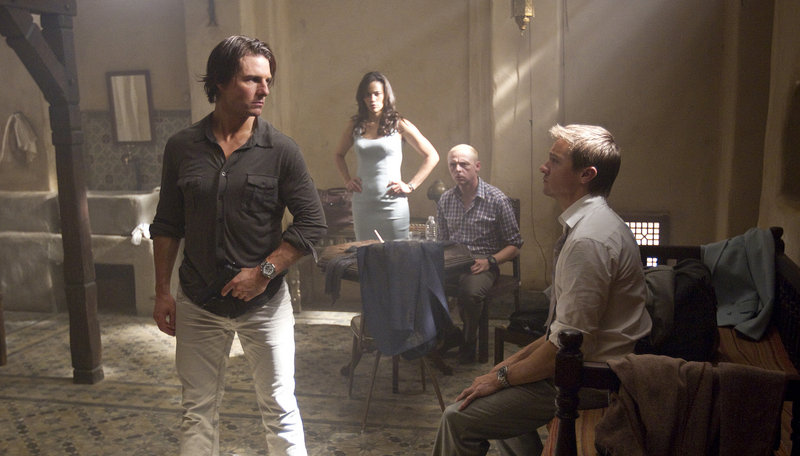 "Tom Cruise plays Ethan Hunt, with Paula Patton as Jane, Simon Pegg as Benji, and Jeremy Renner as Brandt in ""Mission: Impossible - Ghost Protocol."""