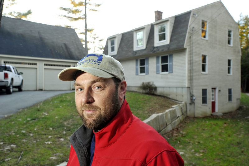 """Aaron Amirault bought this Falmouth home last January for nearly $100,000 below the town's assessed property value. He challenged the assessment and it was decreased, shaving $478 off his tax bill. """"I'm not against paying my fair share,"""" Amirault said. """"I just want it to be based on the real value of my property."""""""