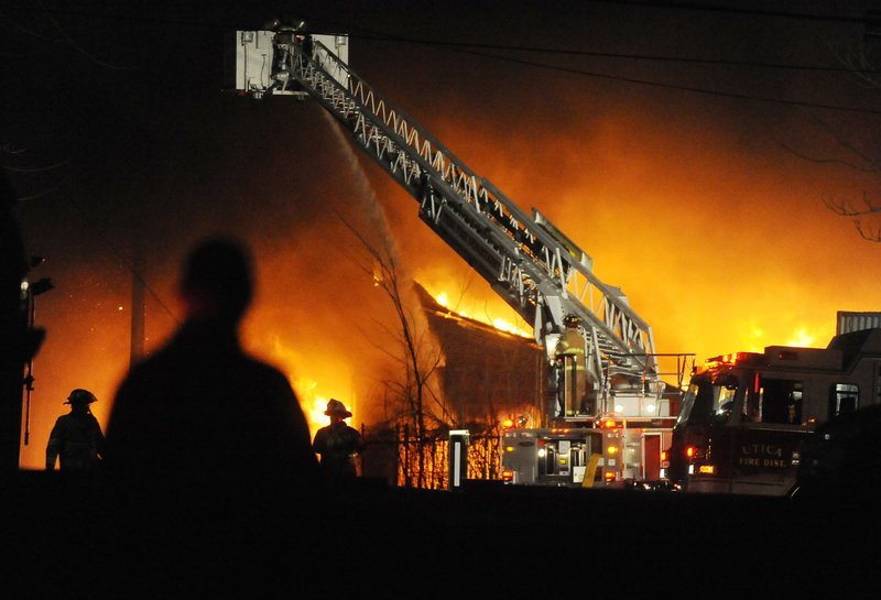 A fire burns early Sunday at the former Westclox Co. clock factory in Peru, Ill. Despite the efforts of firefighters from the surrounding area, the landmark was destroyed by the blaze.