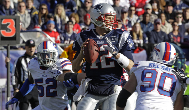 Tom Brady sets up to throw in the first quarter Sunday against the Bills. Brady threw for three TDs as he rallied the Patriots from a three-TD deficit to a 49-21 win at Gillette Stadium, giving New England the top seed in the AFC.