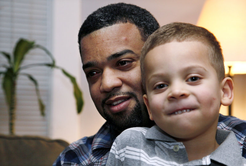 Damon Brown, holding his son Julian, 5, at their home in Seattle, found a kidney donor on Facebook after telling his story there.