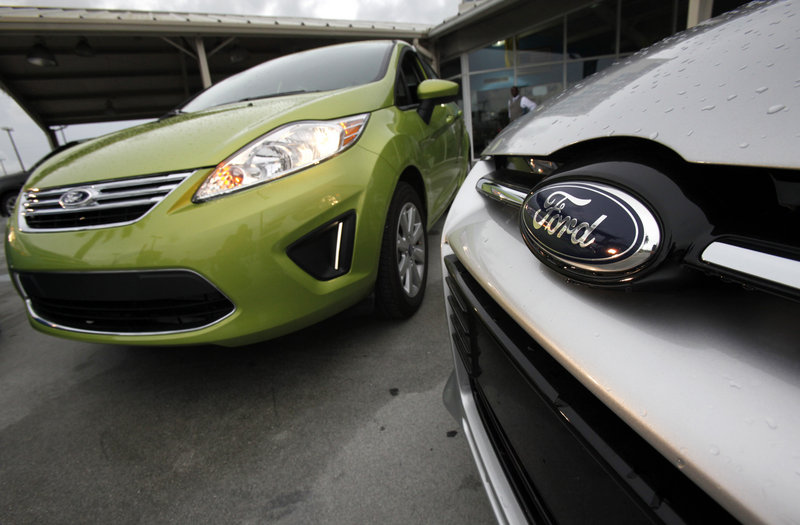 Among Ford's offerings for 2012: A Fiesta SE, left, and a Focus Titanium 5-Door Hatchback.