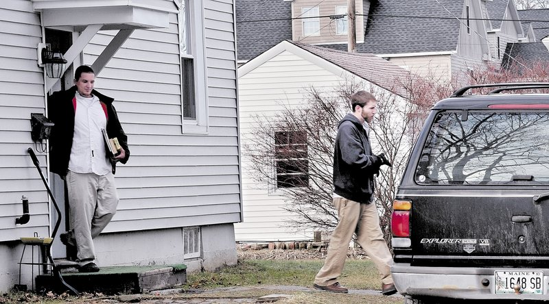 Justin DiPietro, right, leaves his mother's home at 29 Violette Ave. in Waterville on Monday, followed by his brother Lance DiPietro. Justin DiPietro pleaded for the person who took his daughter, Ayla Reynolds, on Dec. 17 to return her to him.