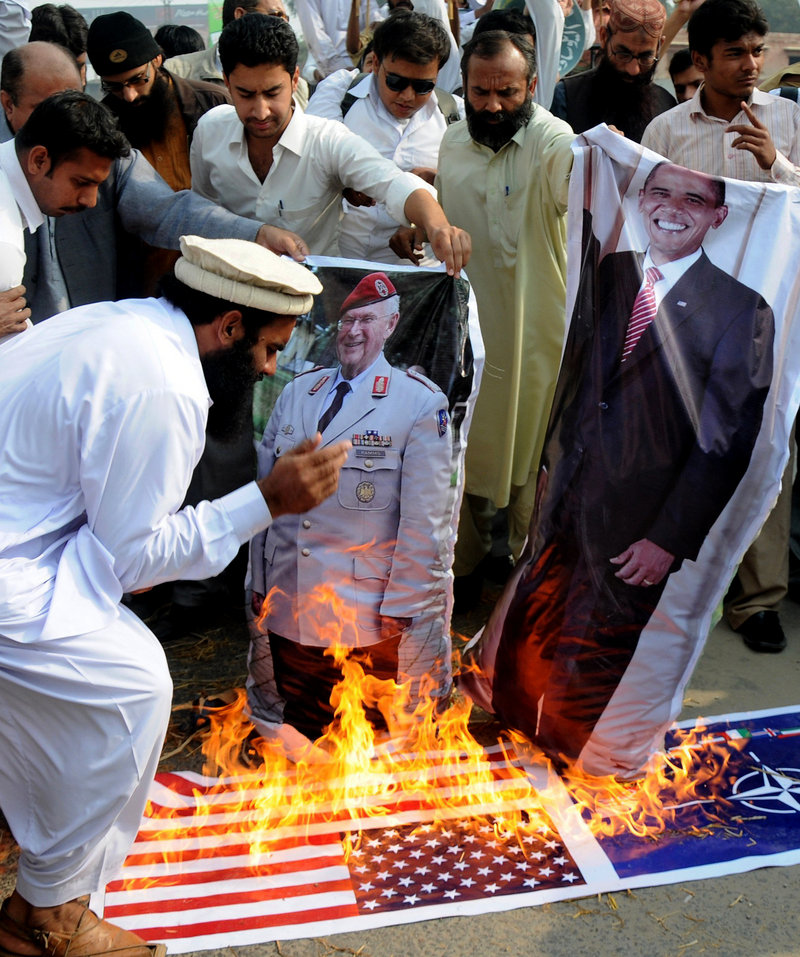 Supporters of the Pakistani religious party Jamatud Dawa burn a representation of the U.S. flag and posters of President Obama and a NATO general during a protest to condemn NATO strikes on Pakistani posts in November.