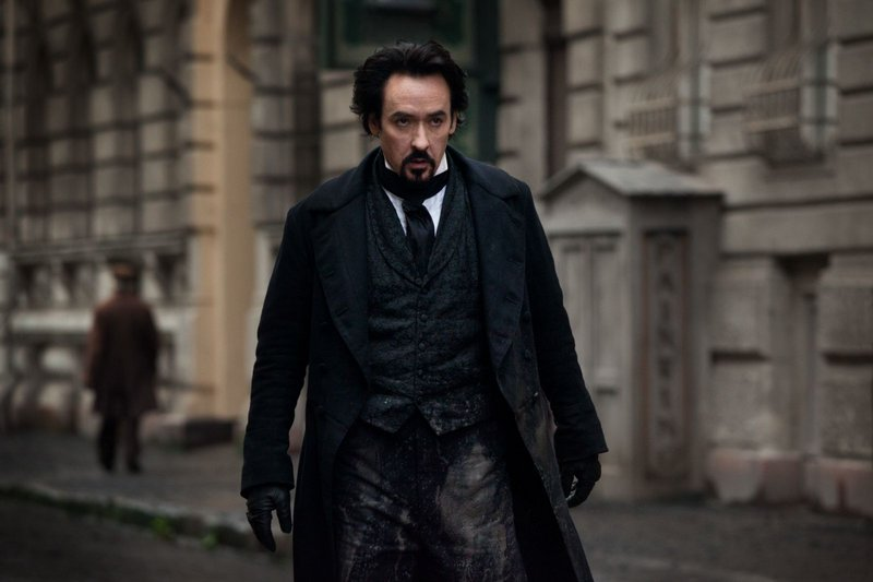 "John Cusack as Edgar Allen Poe in ""The Raven."""