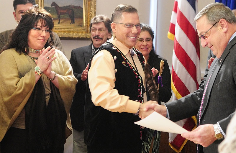 David Slagger, accompanied by his wife, Priscilla, left, greets Gov. Paul LePage after the Kenduskeag lawmaker was sworn in at the State House as Maine's first Maliseet Indian legislator. Two of Maine's four tribes – the Penobscots and Passamaquoddies – had already been represented in the Legislature. Now, with Slagger standing for the Houlton Band of Maliseets, only the Micmacs remain unrepresented.