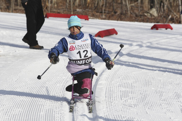 Christina Kouros of Cape Elizabeth handles a turn Wednesday on the way to a silver medal in the adaptive sit-ski competition at the U.S. cross country ski championships.