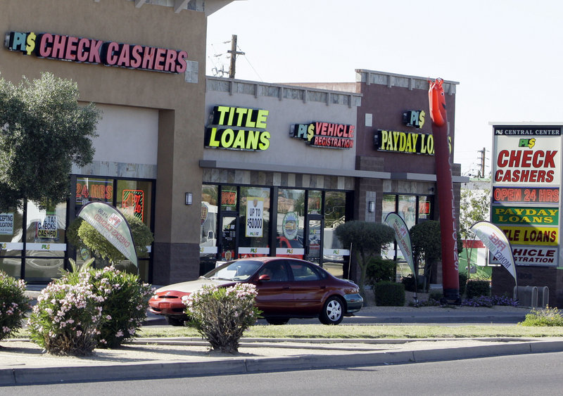 Payday loan businesses, like these in Phoenix, will now face oversight to ensure they disclose the full costs of their short-term loans, so consumers can make informed choices.