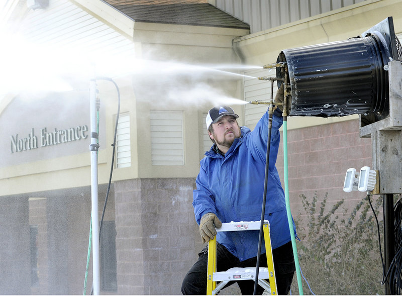 Marcus Corey, event organizer for Biddeford Big Air & Rail Jam, adjusts a snow gun that will make snow for the ski and snowboard event Jan. 13 at the New Life Church in Biddeford.