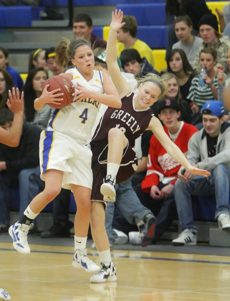 Sydney Hancock of Lake Region controls a loose ball and keeps it from Caroline Hamilton of Greely during Lake Region's 40-27 victory at home Wednesday night.