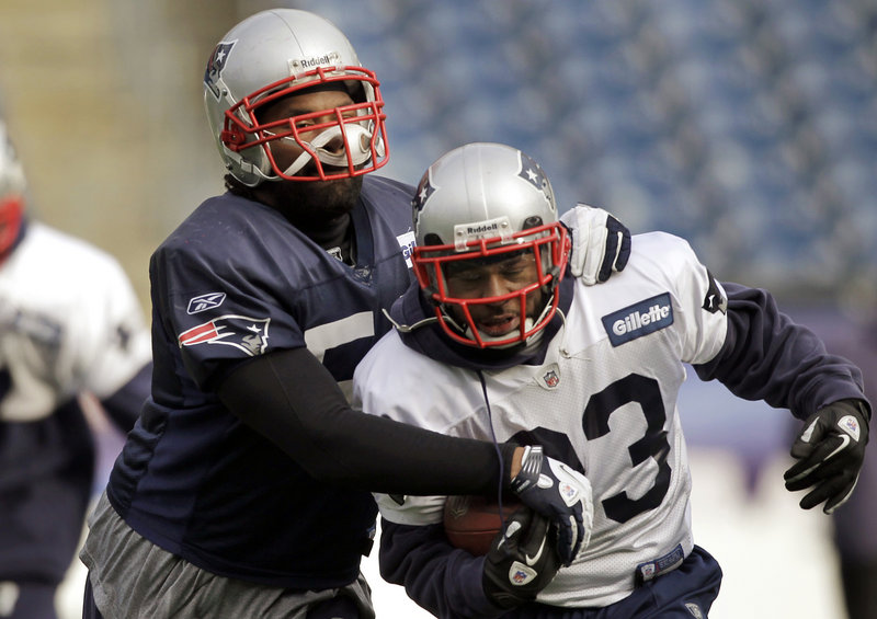 Patriots middle linebacker Jerod Mayo tries to dislodge the football from running back Kevin Faulk during a drill Thursday at team practice in Foxborough, Mass. Mayo has had more than 100 tackles in each of his four NFL seasons, the first Patriot to do that, and led the team each year.