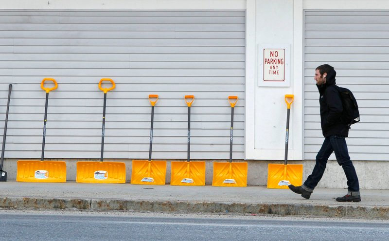 In downtown Bridgton, snow shovels are lined up for sale outside a Renys store. Across much of the nation, most natural snow has either melted or been washed away by rain, costing businesses tens of millions of dollars in lost sales.