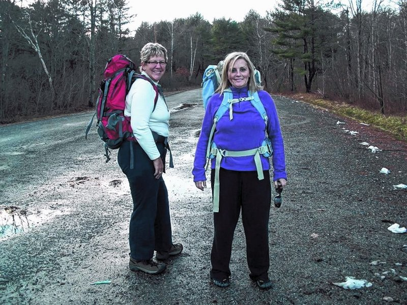 Sue Twombley, left, and Denise Scales take a 7-mile training hike in preparation for an Appalachian Trail thru-hike they'll begin next month.